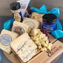 """<p><strong>Rogue Creamery</strong></p><p>goldbelly.com</p><p><strong>$109.00</strong></p><p><a href=""""https://go.redirectingat.com?id=74968X1596630&url=https%3A%2F%2Fwww.goldbelly.com%2Frogue-creamery%2Fbrilliant-blues&sref=https%3A%2F%2Fwww.townandcountrymag.com%2Fleisure%2Fdining%2Fg23937264%2Fgourmet-food-gifts%2F"""" rel=""""nofollow noopener"""" target=""""_blank"""" data-ylk=""""slk:Shop Now"""" class=""""link rapid-noclick-resp"""">Shop Now</a></p><p>In 2019, for the first time ever, an American-made cheese took home the top honors at the World Cheese Awards in Bergamo, Italy. That cheese? Rogue Creamery's Rogue River Blue Cheese. For a patriotic cheese aficionado, what could be better than a sampler of the creamery's beloved blues?</p>"""