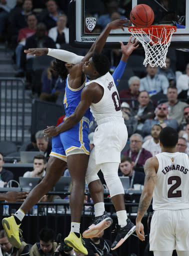 Arizona State's Luguentz Dort, right fouls UCLA's Jalen Hill during the second half of an NCAA college basketball game in the quarterfinals of the Pac-12 men's tournament Thursday, March 14, 2019, in Las Vegas. (AP Photo/John Locher)