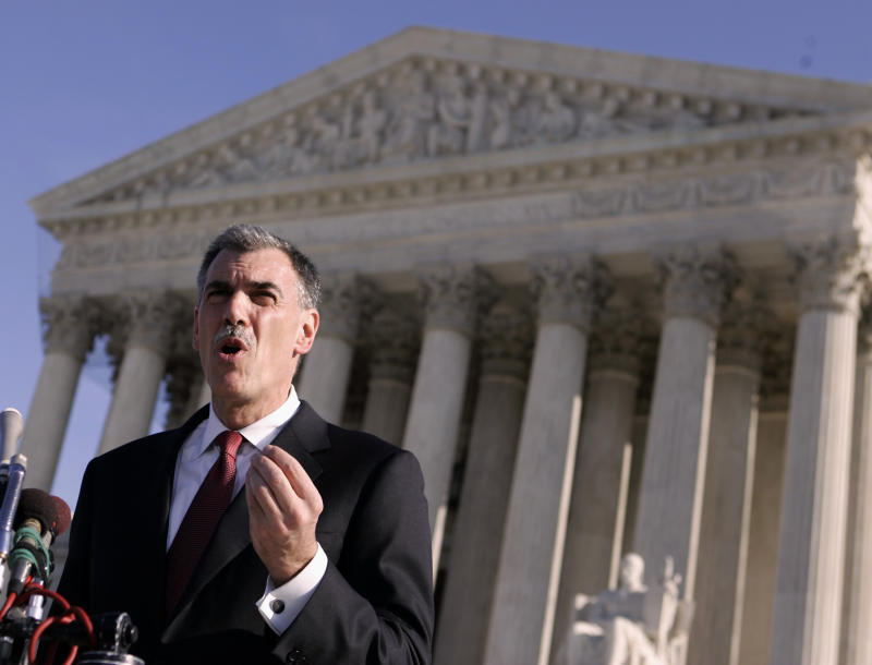 FILE - In a Jan. 7, 2008, file photo then-Attorney Donald Verrilli talks to media outside the Supreme Court. Now President Barack Obama's top Supreme Court lawyer, Solicitor General Verilli will argue before the Supreme Court this week whether it is legal for  patent-holding pharmaceutical companies to pay rivals, who make generic drugs, to temporarily keep those cheaper versions of their brand-name drugs off the market. The Obama administration is taking the position that the agreements are illegal if they're based solely on keeping the generic drug out of consumer's hands. (AP Photo/Evan Vucci, File)