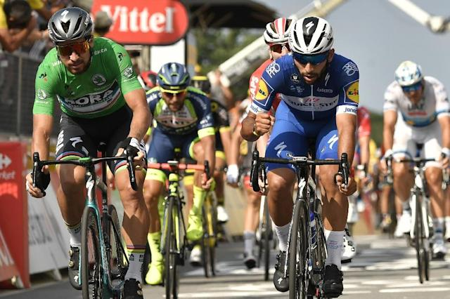 Colombia's Fernando Gaviria (R) reacts after crossing the finish line ahead of Slovakia's Peter Sagan (L) to win the fourth stage of the 105th edition of the Tour de France cycling race between La Baule and Sarzeau, western France, on July 10, 2018. (AFP Photo/Marco BERTORELLO)