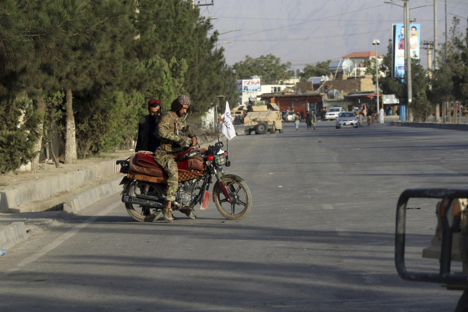 Taliban fighters stand guard at a checkpoint near the gate of Hamid Karzai international Airport in Kabul, Afghanistan, Saturday, Aug. 28, 2021. The Taliban have sealed off Kabul's airport to most would-be evacuees to prevent large crowds from gathering after this week's deadly suicide attack. The massive U.S.-led airlift was winding down Saturday ahead of a U.S. deadline to withdraw from Afghanistan by Tuesday. (AP Photo/Wali Sabawoon)