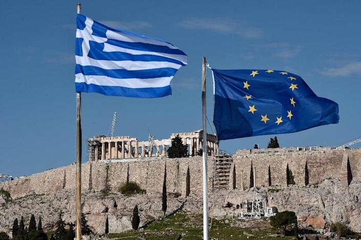 Eurozone ministers approved the launch of Greece bailout talks and the ECB boosted its cash lifeline to the crisis-hit country (AFP Photo/Louisa Gouliamaki)