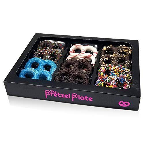 """<p><strong>The Pretzel Plate</strong></p><p>amazon.com</p><p><strong>$21.99</strong></p><p><a href=""""https://www.amazon.com/dp/B08LTTBBFR?tag=syn-yahoo-20&ascsubtag=%5Bartid%7C1782.g.994%5Bsrc%7Cyahoo-us"""" rel=""""nofollow noopener"""" target=""""_blank"""" data-ylk=""""slk:BUY NOW"""" class=""""link rapid-noclick-resp"""">BUY NOW</a></p><p>The best way to eat pretzels is when they're doused in chocolate and sprinkles anyway.</p>"""