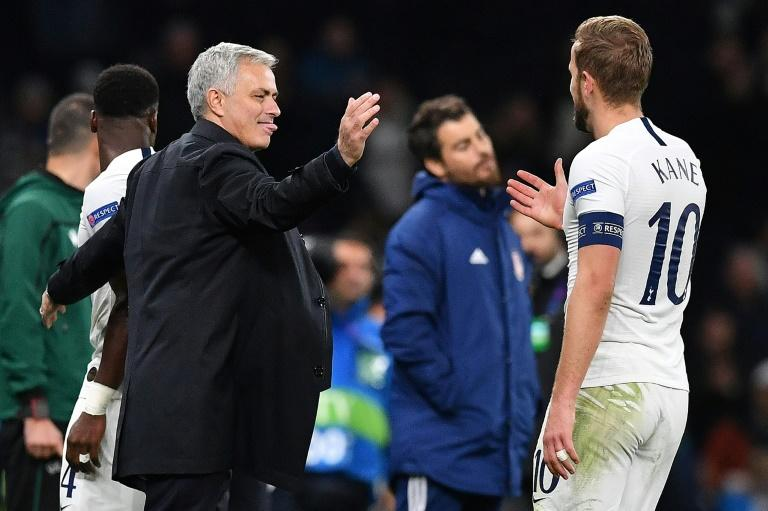 Tottenham manager Jose Mourinho and forward Harry Kane celebrate their victory in the Champions League match against Olympiakos