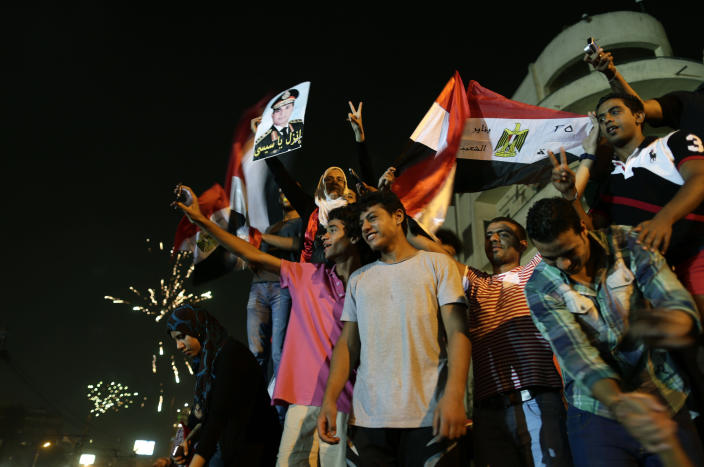"Opponents of Egypt's Islamist leader Mohammed Morsi celebrate outside the presidential palace in Cairo, Egypt, Wednesday, July 3, 2013. A statement on the Egyptian president's office's Twitter account has quoted Mohammed Morsi as calling military measures ""a full coup."" The denouncement was posted shortly after the Egyptian military announced it was ousting Morsi, who was Egypt's first freely elected leader but drew ire with his Islamist leanings. The military says it has replaced him with the chief justice of the Supreme constitutional Court, called for early presidential election and suspended the Islamist-backed constitution. (AP Photo/Hassan Ammar)"
