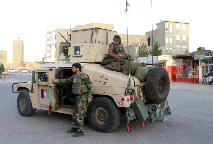 Afghan security personnel patrol after they took back control of parts of Herat city following fighting between Taliban and Afghan security forces in Herat province, west of Kabul, Afghanistan, Friday, Aug. 6, 2021. (AP Photo/Hamed Sarfarazi)