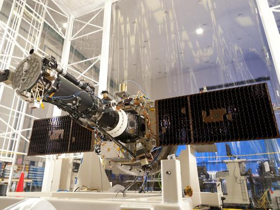 NASA's Interface Region Imaging Spectrograph (IRIS) with solar panels open in flight position, in the clean room at the Lockheed Martin Advanced Technology Center in Palo Alto, where it was designed and built.