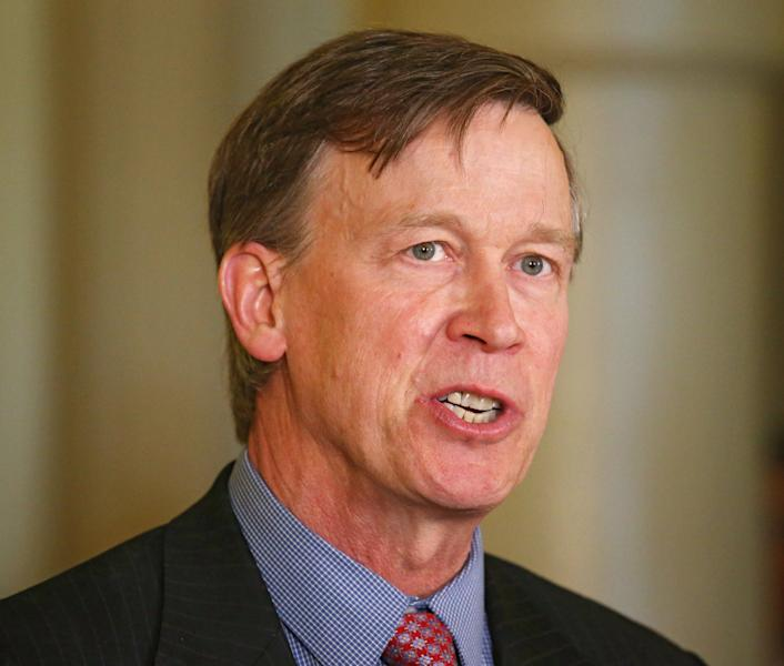 RETRANSMISSION TO CORRECT YEAR OF MURDERS - Colorado Gov. John Hickenlooper speaks at a news conference at the Capitol in Denver on Wednesday, May 22, 2013 where he announced that he was granting a temporary reprieve to Nathan Dunlap from his death sentence. Dunlap was scheduled to be executed in August for the murders of four people in 1993 at a Chuck E. Cheese restaurant. Hickenlooper only referred to Dunlap as Offender NO. 89148. He would not use Dunlap's name. (AP Photo/Ed Andrieski)