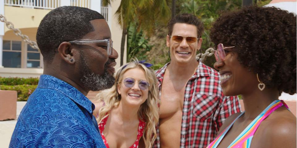 """Marcus (Lil Rel Howery, far left) and Emily (Yvonne Orji) have a getaway upended by Kyla (Meredith Hagner) and Ron (John Cena) in """"Vacation Friends."""""""