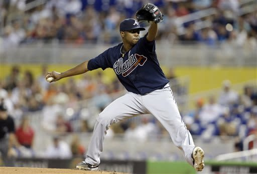 Atlanta Braves starting pitcher Julio Teheran throws in the first inning during a baseball game against the Miami Marlins, Tuesday, July 9, 2013 in Miami. (AP Photo/Lynne Sladky)