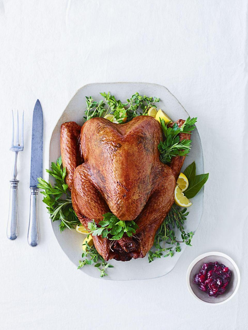 """<p>... and fill up the bird's cavity with herbs and aromatics. Instead of packing your bird with bread cubes that inevitably turn soggy (we prefer a <a href=""""https://www.goodhousekeeping.com/food-recipes/a5166/traditional-bread-stuffing-herbs-1473/"""" rel=""""nofollow noopener"""" target=""""_blank"""" data-ylk=""""slk:crispy-topped stuffing"""" class=""""link rapid-noclick-resp"""">crispy-topped stuffing</a> cooked on the side), stuff the turkey with fresh whole herbs, lemon halves, shallots and smashed cloves of garlic that lend tons of flavor with zero mush.</p>"""