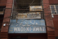 Billboards with names of newspapers stand at the entrance of a building at Press Enclave, which houses many newspaper offices, in Srinagar, Indian-controlled Kashmir, Wednesday, Sept. 8, 2021. Police raided the homes of four journalists on Wednesday, triggering concerns of a further crackdown on press freedom in the disputed region. After the raids in Srinagar, the region's main city, the four journalists were summoned to local police stations where they were questioned. Police did not specify the reason for the raids. (AP Photo/Mukhtar Khan)