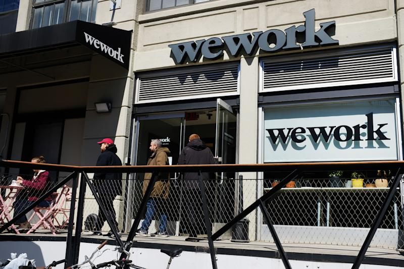 NEW YORK, NEW YORK - MARCH 26: People walk out of the co-working space WeWork in the Williamsburg neighborhood in Brooklyn on March 26, 2019 in New York City. WeWork, which lets freelancers and other non-traditional workers to become members in a shared or flexible office space, has expanded globally over the last year but continues to suffer large losses. While in 2018 WeWork saw a more than doubling of its sales to $1.82 billion from a year earlier, the company's losses over that same period also more than doubled to $1.93 billion. (Photo by Spencer Platt/Getty Images)