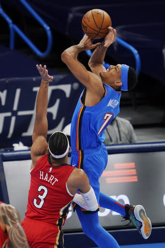 Oklahoma City Thunder forward Darius Bazley (7) is fouled by New Orleans Pelicans guard Josh Hart (3) as he shoots during the second half of an NBA basketball game Thursday, Dec. 31, 2020, in Oklahoma City. (AP Photo/Sue Ogrocki)