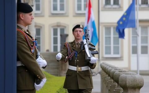 A guard walks in front of The Grand Ducal Palace in Luxembourg, 23 April 2019 - Credit: Rex