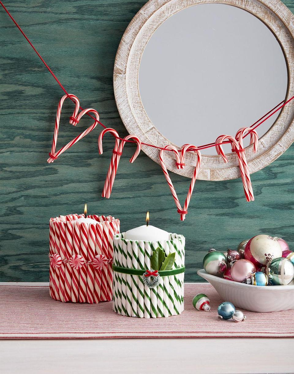 """<p>Invite friends over to craft fresh holiday decor out of peppermint sticks and candy canes. The season's most ubiquitous treat is more versatile than you think! Besides candy canes, peppermint sticks and peppermints, <a href=""""https://www.amazon.com/chandler-tool-hot-glue-gun/dp/B07G9PVRSB?tag=syn-yahoo-20&ascsubtag=%5Bartid%7C10050.g.2218%5Bsrc%7Cyahoo-us"""" rel=""""nofollow noopener"""" target=""""_blank"""" data-ylk=""""slk:hot glue guns"""" class=""""link rapid-noclick-resp"""">hot glue guns</a>, <a href=""""https://www.amazon.com/656Feet-Cotton-Cooking-Kitchen-Wrapping-2mm/dp/B07KQQL982/ref=sr_1_3?tag=syn-yahoo-20&ascsubtag=%5Bartid%7C10050.g.2218%5Bsrc%7Cyahoo-us"""" rel=""""nofollow noopener"""" target=""""_blank"""" data-ylk=""""slk:red cotton string"""" class=""""link rapid-noclick-resp"""">red cotton string</a>, <a href=""""https://www.amazon.com/Glass-Cylinder-Vases-Inch-Tall/dp/B07PWMYZM3/ref=sr_1_13?tag=syn-yahoo-20&ascsubtag=%5Bartid%7C10050.g.2218%5Bsrc%7Cyahoo-us"""" rel=""""nofollow noopener"""" target=""""_blank"""" data-ylk=""""slk:glass pillar candle holders"""" class=""""link rapid-noclick-resp"""">glass pillar candle holders</a>, and <a href=""""https://www.amazon.com/QIANF-Vintage-Green-Velvet-Ribbon/dp/B07FCM4R8Y/ref=sr_1_2_sspa?tag=syn-yahoo-20&ascsubtag=%5Bartid%7C10050.g.2218%5Bsrc%7Cyahoo-us"""" rel=""""nofollow noopener"""" target=""""_blank"""" data-ylk=""""slk:festive ribbons"""" class=""""link rapid-noclick-resp"""">festive ribbons</a> are just a few must-haves. </p><p><a class=""""link rapid-noclick-resp"""" href=""""https://www.amazon.com/Vesil-Mini-Christmas-Wreaths-Decorations/dp/B07ZP43BVY/ref=sr_1_2?tag=syn-yahoo-20&ascsubtag=%5Bartid%7C10050.g.2218%5Bsrc%7Cyahoo-us"""" rel=""""nofollow noopener"""" target=""""_blank"""" data-ylk=""""slk:SHOP BOTTLE BRUSH WREATH"""">SHOP BOTTLE BRUSH WREATH</a></p>"""