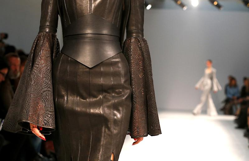 A model wears a creation by British fashion designer Gareth Pugh for his fashion house's Spring Summer 2013 ready to wear collection, for Fashion Week, in Paris, Wednesday, Sept.26, 2012.(AP Photo/Jacques Brinon)