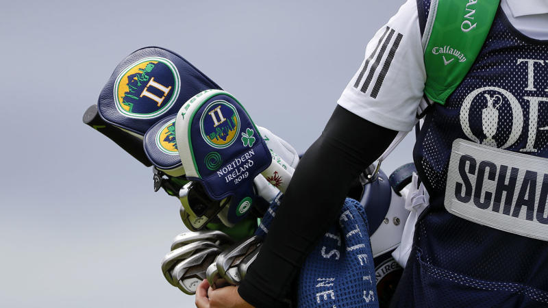 Xander Schauffele's caddie carries his bag at the British Open. (Photo by Kevin C. Cox/Getty Images)