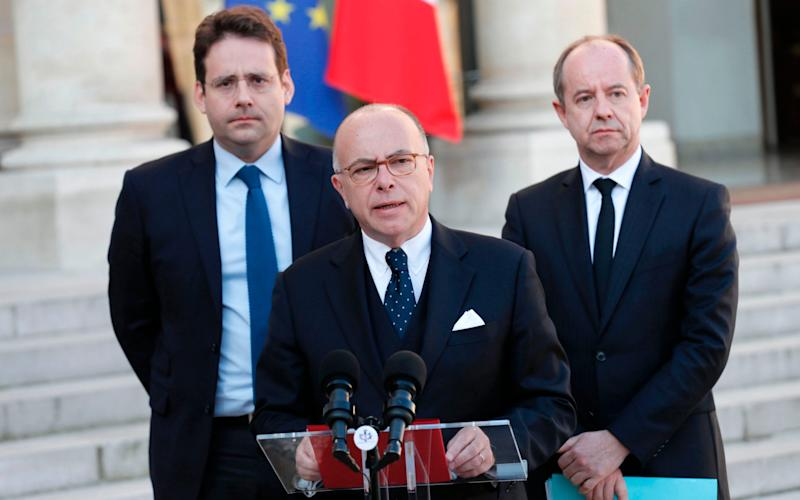 French Prime Minister Bernard Cazeneuve speaks next to Interior Minister Matthias Fekl (L) and Justice Minister Jean-Jacques Urvoas - Credit: THOMAS SAMSON/AFP/Getty Images