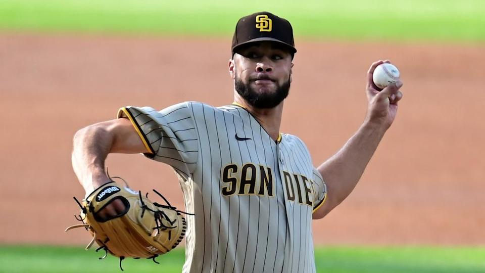 Joey Lucchesi prepares to deliver pitch with Padres, close crop eyes visible