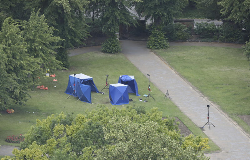 An aerial view showing police tents in Forbury Gardens at the scene of a multiple stabbing attack which took place on Saturday, in Reading, England, Sunday June 21, 2020. Police say a stabbing rampage in Britain that killed three people as they sat in a park on a summer evening is being considered a terrorist attack. A 25-year-old man believed to be the lone attacker is in custody. (Jonathan Brady/PA via AP)