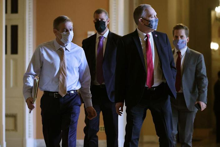 Rep. Jim Jordan (R-OH), lawyer Stephen Castor and Rep. Andy Biggs (R-AZ) walk across the U.S. Capitol on the second day of former President Donald Trump's second impeachment trial at the U.S. Capitol on February 10, 2021 in Washington, DC. (Photo by Chip Somodevilla/Getty Images)