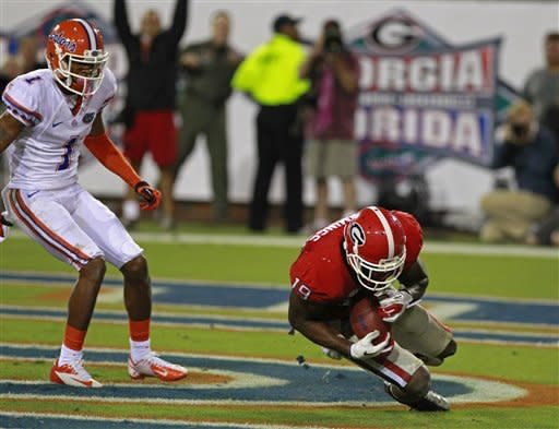 Georgia cornerback Sanders Commings, right, recovers a fumble in the end zone for a touchback in front of Florida wide receiver Quinton Dunbar (1) in the closing minutes of the second half of an NCAA college football game, Saturday, Oct. 27, 2012, in Jacksonville, Fla. (AP Photo/John Raoux)