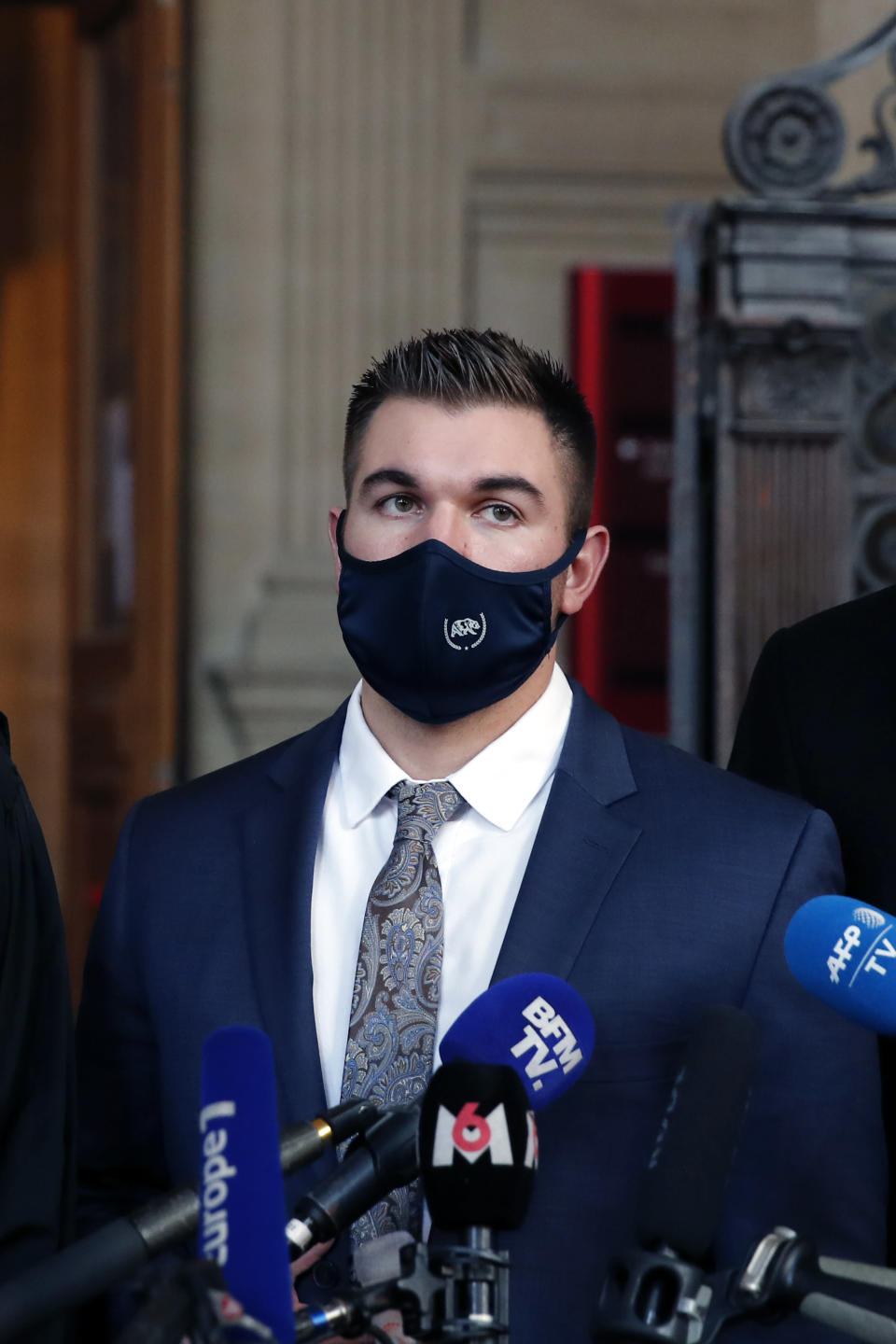 Alek Skarlatos delivers a speech at the end of his hearing during the Thalys attack trial at the Paris courthouse, Friday, Nov. 20, 2020. Passengers who wrestled and disarmed an Islamic State gunman aboard a high-speed Amsterdam to Paris train are recounting how their split-second decisions helped prevent what could have become a mass slaughter. (AP Photo/Francois Mori)