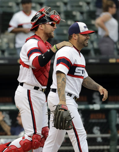 Chicago White Sox relief pitcher Hector Santiago, right, is congratulated by catcher Kevan Smith after the White Sox defeated the Boston Red Sox 8-0 in a baseball game Sunday, Sept. 2, 2018, in Chicago. (AP Photo/Nam Y. Huh)