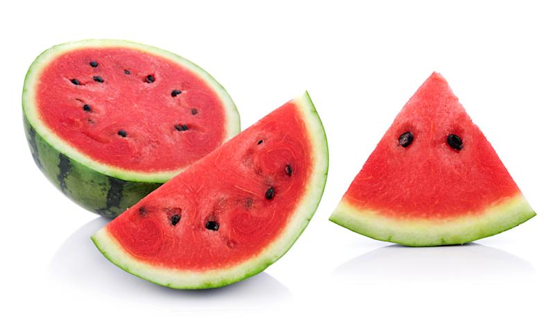 Close-Up Of Watermelon Slice Against White Background
