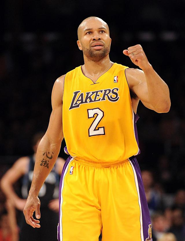 LOS ANGELES, CA - FEBRUARY 29: Derek Fisher #2 of the Los Angeles Lakers celebrates a score against the Minnesota Timberwolves during a 105-84 win at Staples Center on February 29, 2012 in Los Angeles, California. NOTE TO USER: User expressly acknowledges and agrees that, by downloading and or using this photograph, User is consenting to the terms and conditions of the Getty Images License Agreement. (Photo by Harry How/Getty Images)