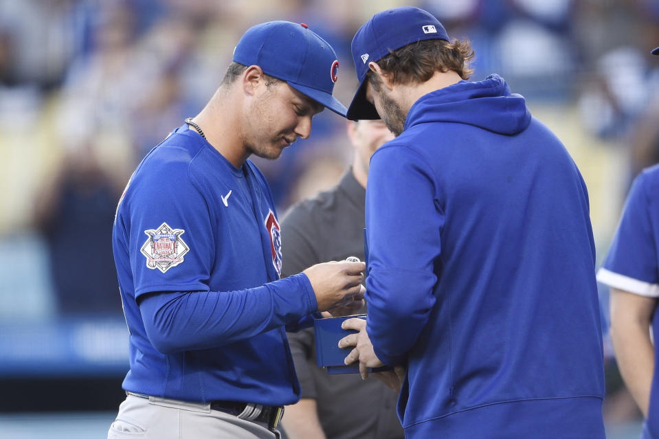 Chicago Cubs' Joc Pederson, left, receives his 2020 World Series ring from Los Angeles Dodgers' Clayton Kershaw before a baseball game in Los Angeles, Thursday, June 24, 2021. (AP Photo/Kelvin Kuo)