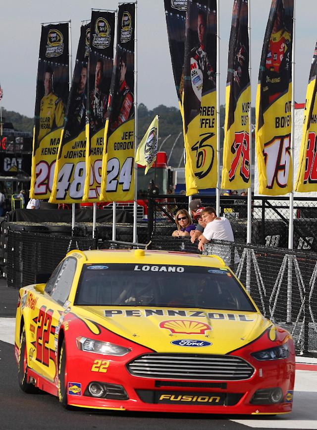 Joey Logano heads for the track during practice for Sunday's NASCAR Sprint Cup Series auto race at Talladega Superspeedway in Talladega, Ala., Friday, Oct. 18, 2013. (AP Photo/Jay Alley)