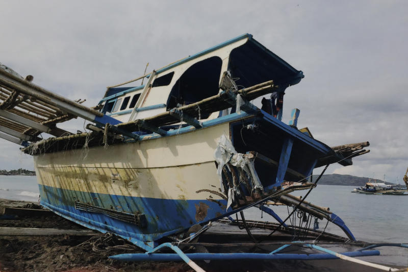 In this undated June 2019 handout photo provided Arlinda dela Torre via the Department of Agriculture, the damaged Filipino fishing boat F/B Gimver 1 lies on the shores at San Jose, Occidental Mindoro province, Philippines. China recently acknowledged its fishing vessel hit a Filipino boat in the disputed South China Sea in an incident that prompted an outcry in the Philippines but denies the collision was intentional. The Philippines has filed a diplomatic protest after Filipino fishermen said a Chinese vessel rammed their anchored boat on Sunday night then abandoned them as the boat sank in the Reed Bank. (Department of Agriculture via AP)