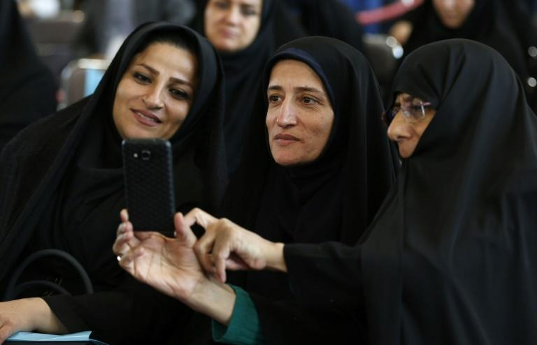 Iranian women attend a political event in Tehran on April 6, 2017