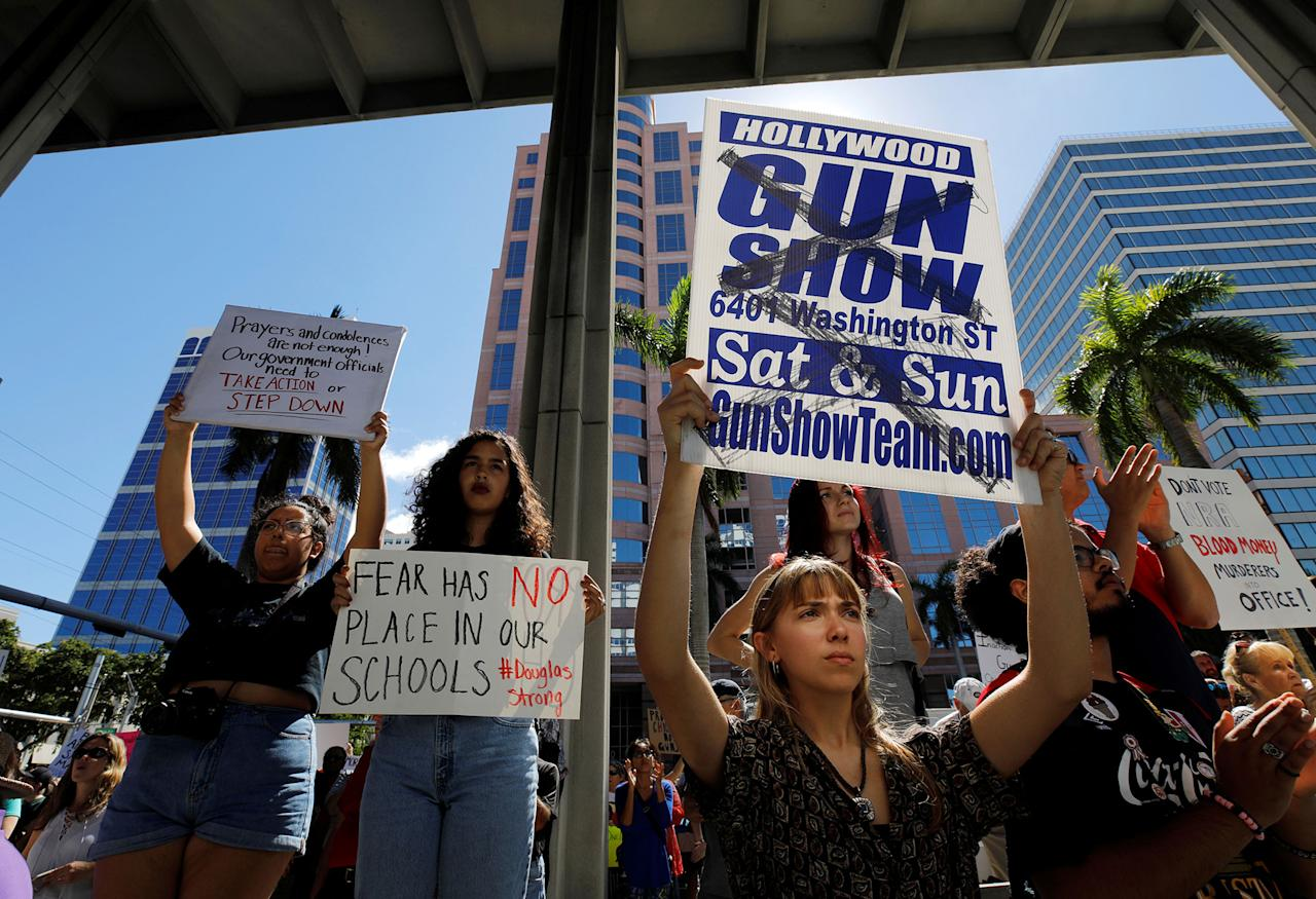 <p>A protester holds a defaced placard at a rally calling for more gun control three days after the shooting at Marjory Stoneman Douglas High School, in Fort Lauderdale, Fla., Feb. 17, 2018. (Photo: Jonathan Drake/Reuters) </p>