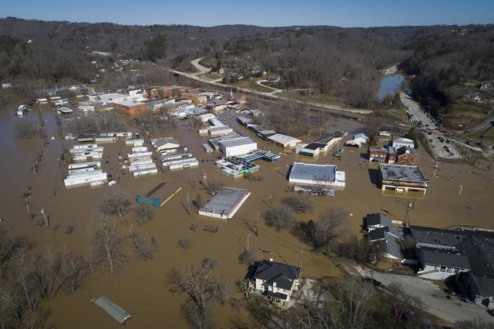 In this photo taken by a drone, the city of Beattyville, Ky., sits underwater following heavy rains which caused the Kentucky River to flood, Tuesday, March 2, 2021. (Alex Slitz/Lexington Herald-Leader via AP)