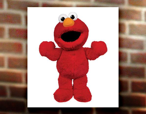 """In 1996, a doll that captured Elmo's distinctive laugh went on the shelves, but """"Tickle Me Elmo"""" wasn't an immediate sell-out. Rosie O'Donnell received one for her son, and in October <a href=""""http://www.media-awareness.ca/english/resources/educational/handouts/advertising_marketing/tickle_me_elmo.cfm"""" rel=""""nofollow"""">she gave out the dolls to audience members in a game</a>. The <a href=""""http://www.time.com/time/specials/packages/article/0,28804,1947621_1947626_1947641,00.html"""" rel=""""nofollow"""">hysteria built</a>, leading to black market prices (reportedly up to $2,000) and a <a href=""""http://www.randomhouse.com/catalog/display.pperl?isbn=9780767926324"""" rel=""""nofollow"""">store stampede</a> that left Wal-Mart employee Robert Waller with a pulled hamstring, broken rib, concussion and, most ignominiously, """"the crotch...yanked out of [his] brand-new jeans."""" As for the voice of Elmo, Clash told the Baltimore Sun in 1996 that he bought one at the store before the toy got big. Later, he received four cases, and the toys proved useful during his renovations with contractors. """"Well, they find out I do Elmo and they trade me for some of this stuff..."""""""