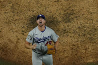 Los Angeles Dodgers relief pitcher Blake Treinen celebrates their win against the Tampa Bay Rays in Game 5 of the baseball World Series Sunday, Oct. 25, 2020, in Arlington, Texas. Dodgers beat the Rays 4-2 to lead the series 3-2 games. (AP Photo/David J. Phillip)