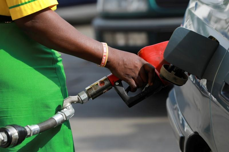 FILE PHOTO: A gas station attendant pumps fuel into a car at the NNPC Mega petrol station in Abuja