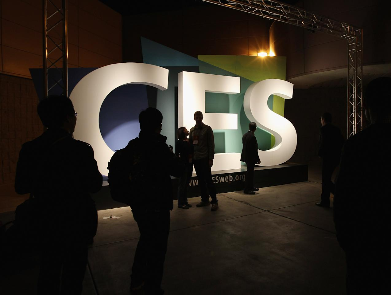 LAS VEGAS, NV - JANUARY 11:  Attendees pose by the CES sign outside the 2012 International Consumer Electronics Show at the Las Vegas Convention Center January 11, 2012 in Las Vegas, Nevada. CES, the world's largest annual consumer technology trade show, runs through January 13 and features more than 3,100 exhibitors showing off their latest products and services to about 140,000 attendees.  (Photo by Bruce Bennett/Getty Images)