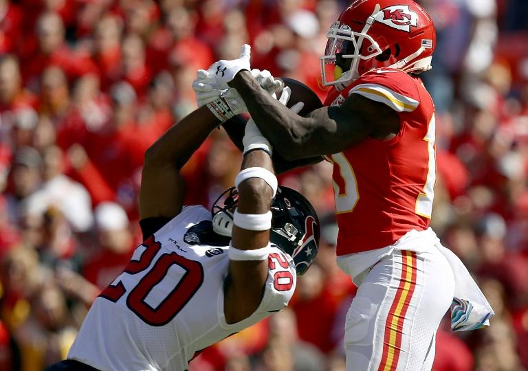 Kansas City Chiefs player Tyreek Hill (R) makes a spectacular touchdown catch but could not inspire his team to victory over the Houston Texans