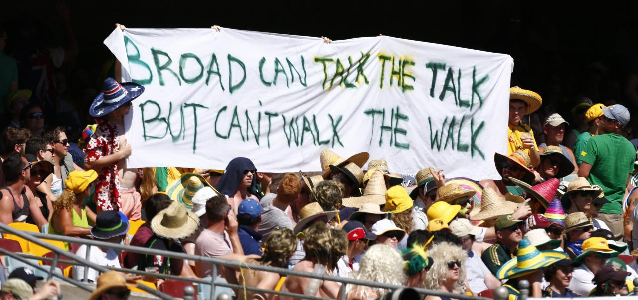 Members from the crowd hold up an anti-Stuart Broad banner during the first day's play of the first Ashes test cricket match between England and Australia in Brisbane November 21, 2013. REUTERS/David Gray (AUSTRALIA - Tags: SPORT CRICKET)