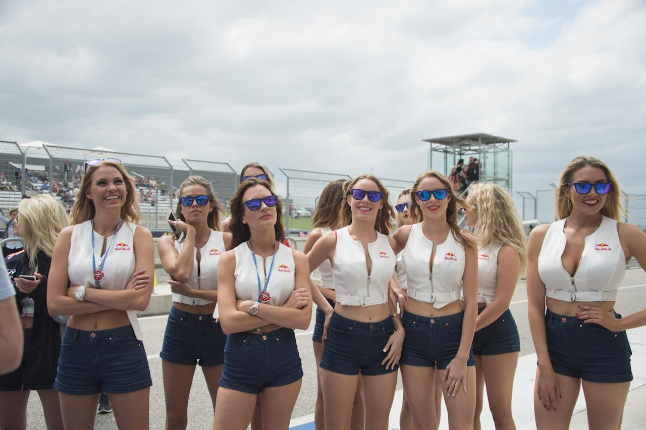 AUSTIN, TEXAS - APRIL 10: The grid girls smile under the podium at the end of the MotoGP race during the MotoGp Red Bull U.S. Grand Prix of The Americas - Race at Circuit of The Americas on April 10, 2016 in Austin, Texas. (Photo by Mirco Lazzari gp/Bongarts/Getty Images)