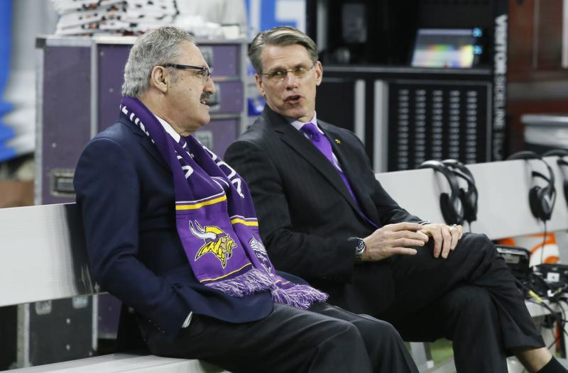 Minnesota Vikings Chairman Zygi Wilf, left, talks with General Manager Rick Spielman during pregame of an NFL football game against the Detroit Lions, Thursday, Nov. 23, 2017, in Detroit. (AP Photo/Duane Burleson)