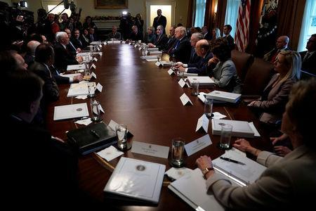 U.S. Vice President Mike Pence addresses comments to U.S. President Donald Trump at the start of a cabinet meeting at the White House in Washington, U.S., December 20, 2017. REUTERS/Jonathan Ernst