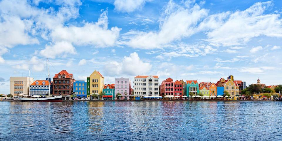 """<p>Curaçao, 35 miles north of Venezuela (part of the ABC island chain along with Aruba and Bonaire), is the largest of the Dutch Antilles. The capital of Willemstad has shops, museums, and waterfront cafes, while nearby beaches include Knip Bay for snorkeling and Playa Kalki, a great spot to catch the sunset. Nature-lovers can hike in <a rel=""""nofollow noopener"""" href=""""https://www.tripadvisor.com/Attraction_Review-g147279-d148152-Reviews-Mount_Christoffel-Christoffel_National_Park_Curacao.html"""" target=""""_blank"""" data-ylk=""""slk:Christoffel National Park"""" class=""""link rapid-noclick-resp"""">Christoffel National Park</a>, home to the island's tallest peak. </p>"""