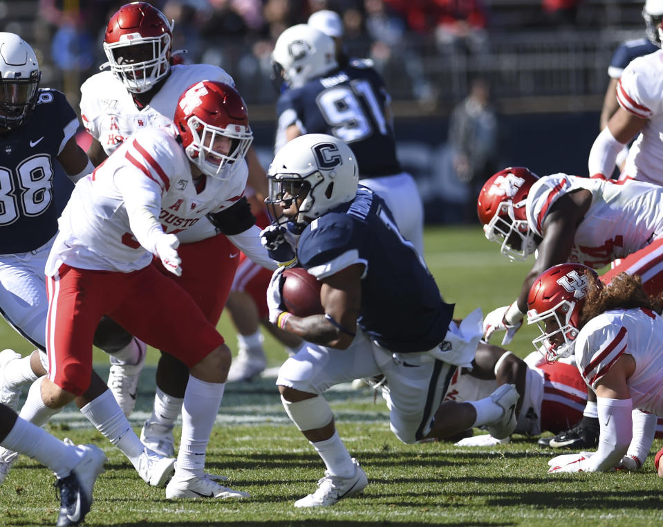 Connecticut running back Art Thompkins (1) gains yardage during the second half of an NCAA college football game against Houston, Saturday, Oct. 19, 2019, in East Hartford, Conn. (AP Photo/Stephen Dunn)