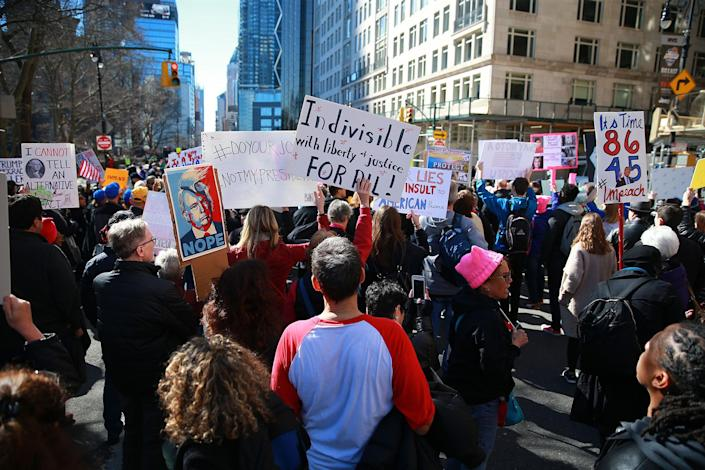 """<p>Demonstrators holds up signs during the """"Not My President's Day"""" rally at Central Park West in New York City on Feb. 20, 2017. (Gordon Donovan/Yahoo News) </p>"""