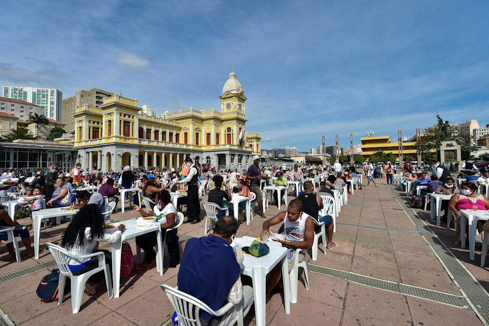 People eat at an open-air restaurant on June 5, 2020, in Belo Horizonte, Brazil. About 3,000 meals are being distributed every Friday, in addition to food, fruit and water. The city has a decades-long policy of guaranteeing residents affordable, healthy food. Credit: Pedro Vilela/Getty Images (Photo: )